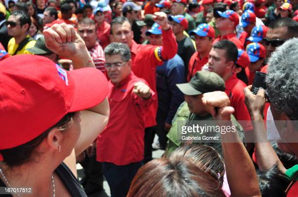In walked prosecion where the coffin of President hugo Chavez the March 6 most government cabinet attended and marched together with the people. In...