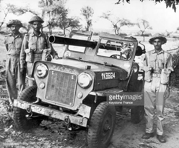 In Western Pakistan during the second IndoPakistani war three Pakistani soldiers surrounded a Willis Jeep equipped with a canon and abandonned by...
