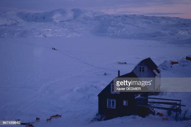 In winter arriving by sled at the village of Tiniteqilaaq Directly opposite the village there is a strait which sometimes dries up and which joins...