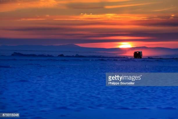 In winter the inhabitants travel on the frozen lake with all types of means of transport bicycles motorbikes cars trucks are used to travel on the...