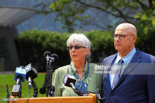 Ina and David Steiner talk to the media behind the John Joseph Moakley United States Courthouse in Boston on July 21, 2021. They filed a civil suit...