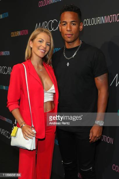 Ina Aogo and Dennis Aogo at the Marc Cain fashion show during the Berlin Fashion Week Spring/Summer 2020 at Velodrom on July 02 2019 in Berlin Germany