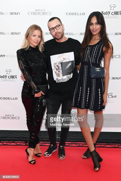 Ina Aogo Marcell von Berlin and Jill Asemota during the Marcell von Berlin 'Genesis' collection presentation on July 3 2017 in Berlin Germany