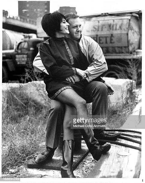 Ina Balin and Chuck McCann hold each other in a scene from the film 'The Projectionist' 1971