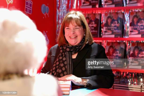 Ina Garten signs cookbooks during Food Network's 25th Birthday Party Celebration at the 11th annual New York City Wine Food Festival at Pier 92 on...