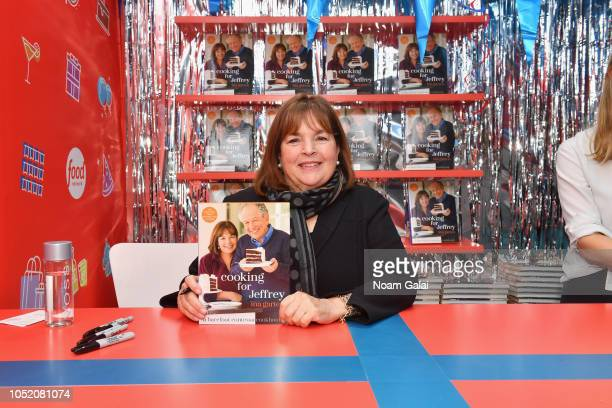 Ina Garten signs cookbooks during the Food Network's rooftop birthday party hosted by Alton Brown Giada De Laurentiis Bobby Flay and Ina Garten at...