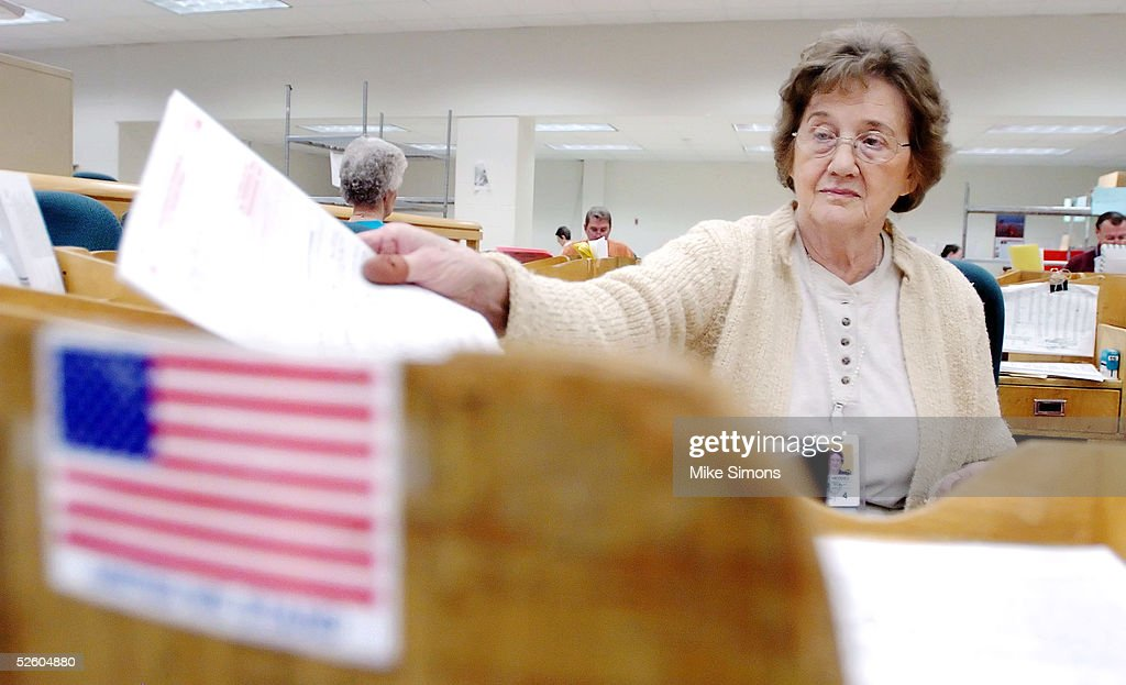 Ina Hedges sorts tax returns at the Cincinnati Internal Revenue Service Center April 8, 2005 in Covington, Kentucky. The tax filing deadline is a week away.
