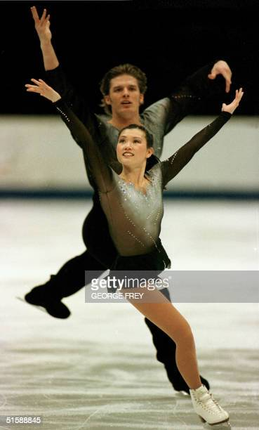 Ina Kyoka and John Zimmerman from the United States skate in the Pairs Short Program at the Four Continents Championships 07 February 2001 in Salt...