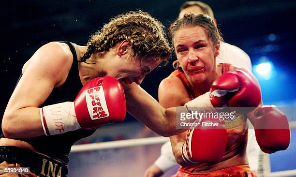Ina Maenzer of Germany hits Silke Weickenmeier of Germany during their WIBF Featherweight Championship fight at the Brandberge Arena on October 22...
