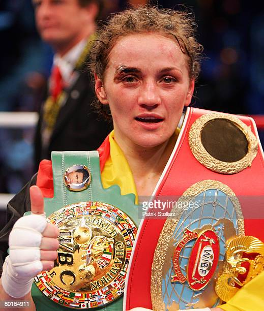 Ina Menzer of Germany celebrates after win over Sandy Tsagouris of Canada during their Featherweight WIBF and WBC World Championship fight at Koenig...