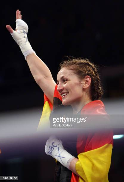 Ina Menzer of Germany celebrates after winning against Stacey Reile of USA after their featherweight WIBF & WBC World Championship fight at the...