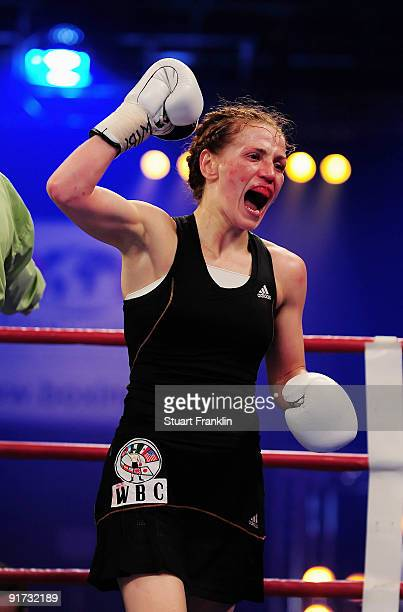 Ina Menzer of Germany celebrates winning against Esther Schouten of the Netherlands during the WIBF WBC and WBO world championship fight during the...