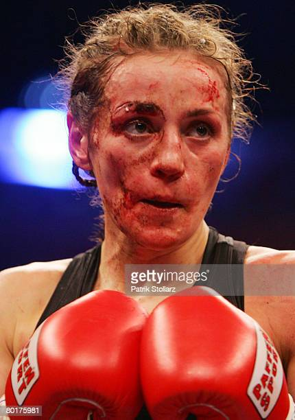 Ina Menzer of Germany concentrates during their Featherweight WIBF and WBC World Championship fight against Sandy Tsagouris of Canada at Koenig...