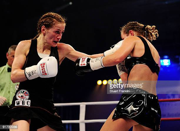 Ina Menzer of Germany exchanges punches with Esther Schouten of the Netherlands during the WIBF WBC and WBO world championship fight during the...