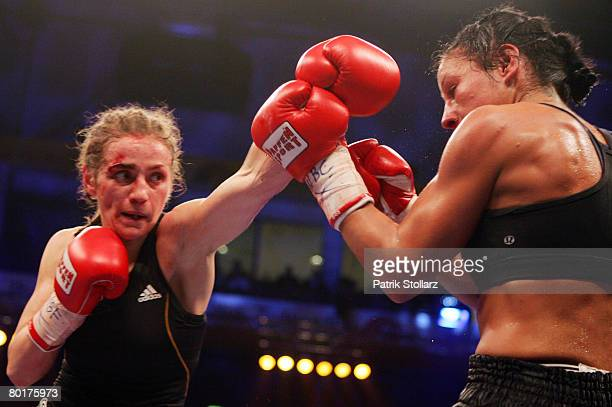 Ina Menzer of Germany fights with Sandy Tsagouris of Canada during their Featherweight WIBF and WBC World Championship fight at Koenig Palast on...