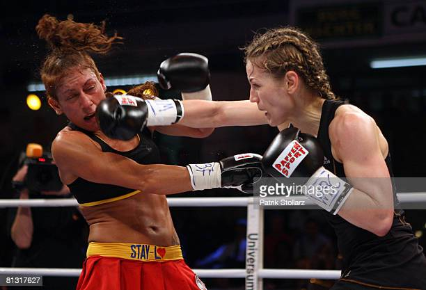 Ina Menzer of Germany fights with Stacey Reile of USA during their featherweight WIBF WBC World Championship fight at the BurgWaechter Castello on...