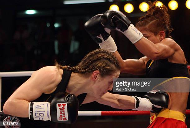 Ina Menzer of Germany fights with Stacey Reile of USA during their featherweight WIBF & WBC World Championship fight at the Burg-Waechter Castello on...