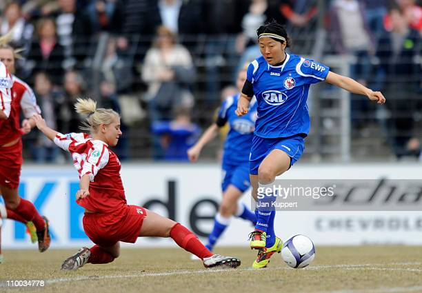 Ina Mester of Essen and Yuki Nagasato of Potsdam battle for the ball during the Women Bundesliga match between Turbine Potsdam and Essen-Schoenebeck...