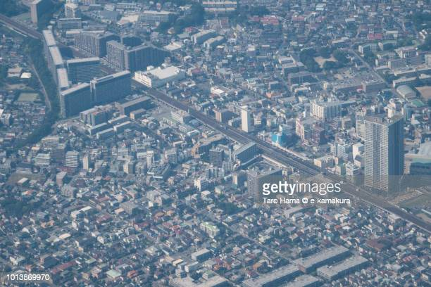 JR Inage station in Chiba city in Japan daytime aerial view from airplane