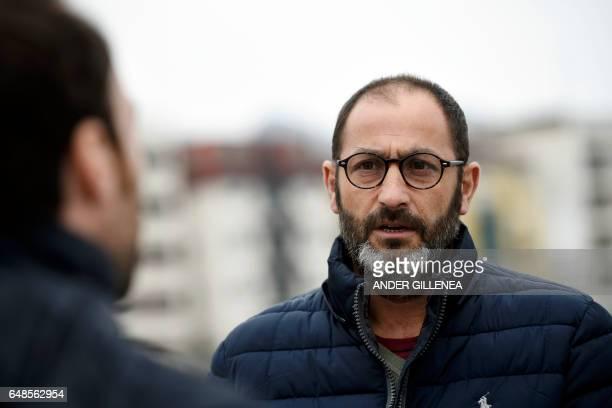 Inaki Artola cousin of Paris SaintGermain's coach Unai Emery speaks with journalists in the northern Spanish Basque village of Hondarribia on...