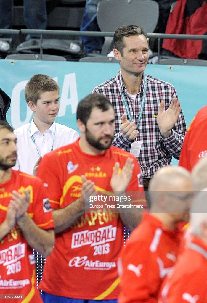 Inaki Urdangarin (R) and his kid Juan Valentin Urdangarin (L) attend the Men's Handball World Championship 2013 final match between Spain and Denmark at Palau Sant Jordi on January 27, 2013 in Barcelona, Spain.
