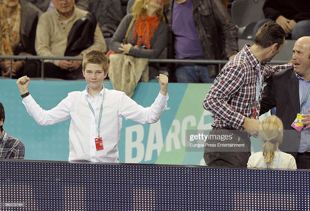 Inaki Urdangarin (2L) and his kids Juan Valentin Urdangarin (L) and Irene Urdangarin (3L) attend the Men's Handball World Championship 2013 final match between Spain and Denmark at Palau Sant Jordi on January 27, 2013 in Barcelona, Spain.