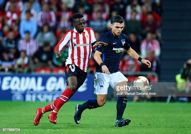 Inaki Willams of Athletic Club duels for the ball with Karim Rekik of Hertha BSC during the UEFA Europa League group J match between Athletic Bilbao...