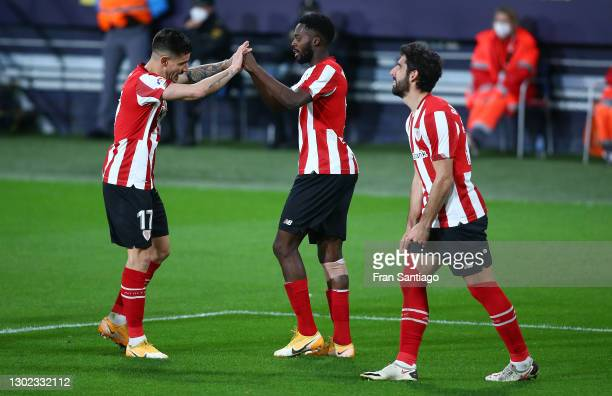 Inaki Williams of Athletic Bilbao celebrates with teammate Yuri Berchiche scoring their team's fourth goal during the La Liga Santander match between...