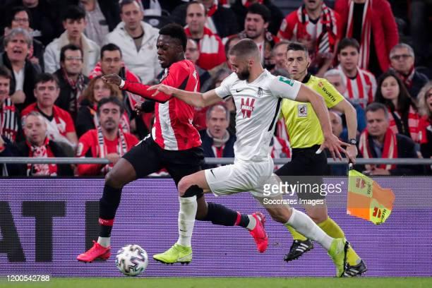 Inaki Williams of Athletic Bilbao Domingos Duarte of Granada CF during the Spanish Copa del Rey match between Athletic de Bilbao v Granada at the...