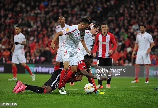 Inaki Williams of Athletic Bilbao falls before Steven N'Zonzi of Sevilla FC during the UEFA Europa League Quarter Final First Leg match between...