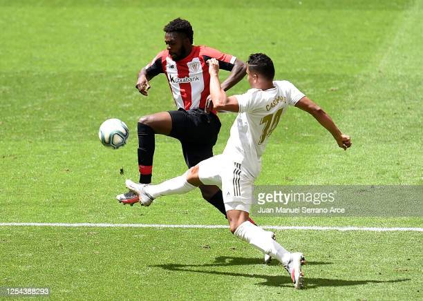 Inaki Williams of Athletic Bilbao is challenged by Casemiro of Real Madrid during the La Liga match between Athletic Club and Real Madrid CF at San...
