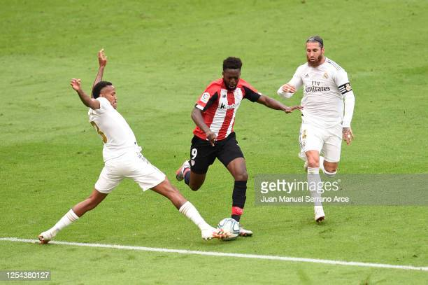 Inaki Williams of Athletic Bilbao is challenged by Eder Militao of Real Madrid and Sergio Ramos of Real Madrid during the La Liga match between...