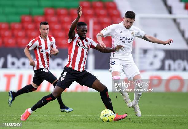 Inaki Williams of Athletic Club battles for possession with Federico Valverde of Real Madrid during the La Liga Santander match between Athletic Club...