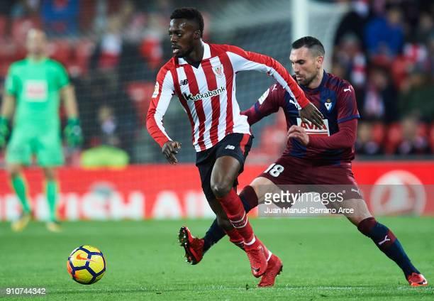 Inaki Williams of Athletic Club being followed by Anaitz Arbilla of SD Eibar during the La Liga match between Athletic Club and Eibar at Estadio San...