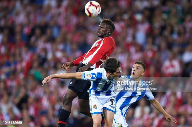 Inaki Williams of Athletic Club competes for the ball with Aritz Elustondo of Real Sociedad and Andoni Gorosabel of Real Sociedad during the La Liga...