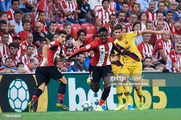 Inaki Williams of Athletic Club competes for the ball with Sergi Roberto of FC Barcelona during the Liga match between Athletic Club and FC Barcelona...