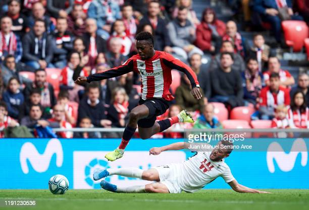 Inaki Williams of Athletic Club duels for the ball with Joaquin Marin 'Quini' of Granada CF during the Liga match between Athletic Club and Granada...