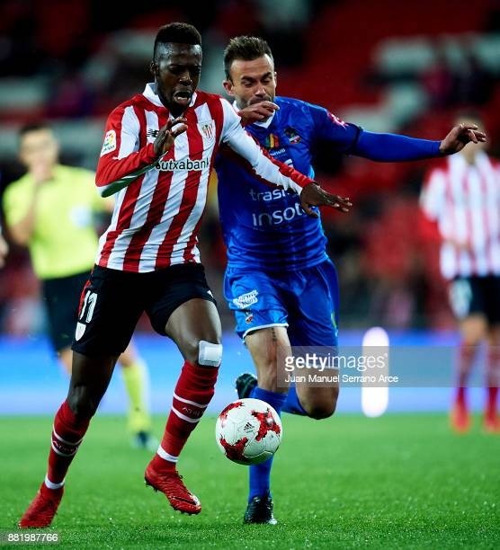 Inaki Williams of Athletic Club duels for the ball with Samuel San Jose Fernandez of SD Formentera during the Copa del Rey Round of 32 Second Leg...