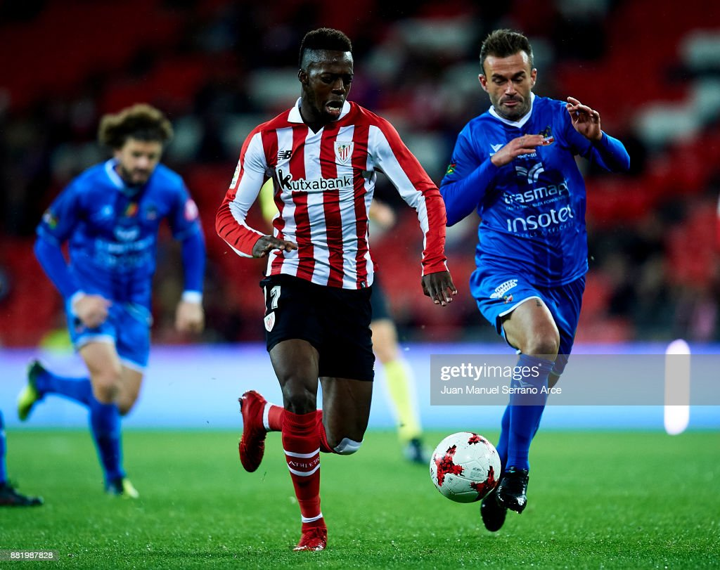 Inaki Williams of Athletic Club duels for the ball with Samuel San Jose Fernandez of SD Formentera during the Copa del Rey, Round of 32, Second Leg match between Athletic Club and SD Formentera at San Mames Stadium on November 29, 2017 in Bilbao, Spain.