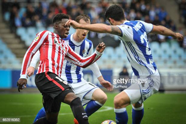 Inaki Williams of Athletic Club duels for the ball with Zurutuza and Raul Navas of Real Sociedad during the Spanish league football match between...