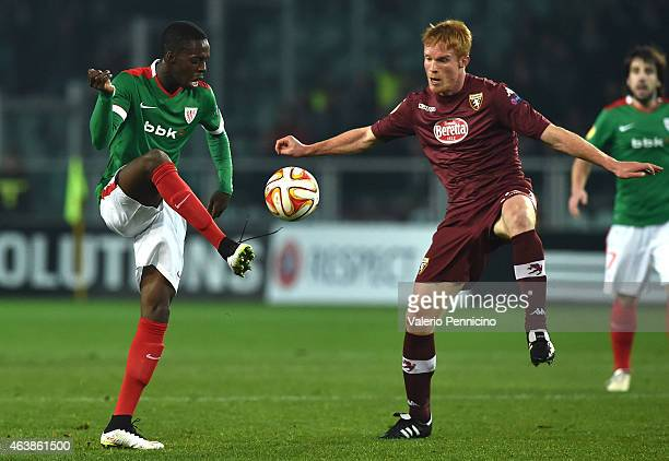 Inaki Williams of Athletic Club in action against Alessandro Gazzi of Torino FC during the UEFA Europa League Round of 32 match between Torino FC and...