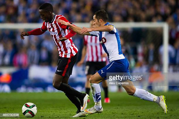 Inaki Williams of Athletic Club runs with the ball close to Lucas Vazquez of RCD Espanyol during the Copa del Rey SemiFinal Second Leg match between...