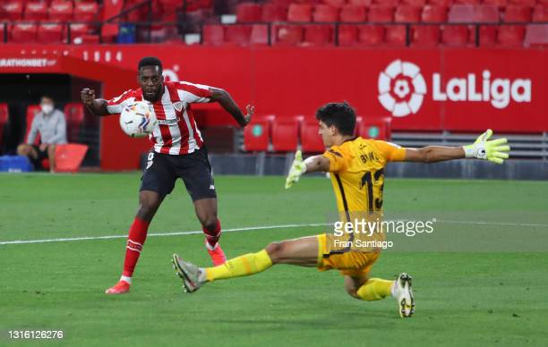Inaki Williams of Athletic Club scores their side's first goal past Yassine Bounou of Sevilla during the La Liga Santander match between Sevilla FC...