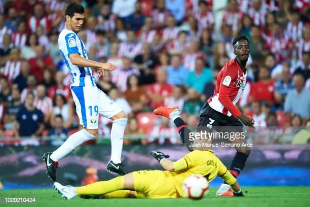 Inaki Williams of Athletic Club shoots the ball through Ivan Cuellar and Ezequiel Matias Munoz of CD Leganes during the La Liga match between...