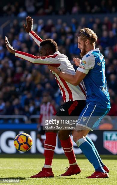 Inaki Williams of Athletic de Bilbao is challenged by Raul Albentosa of Deportivo de La Coruna during the La Liga match between Deportivo La Coruna...