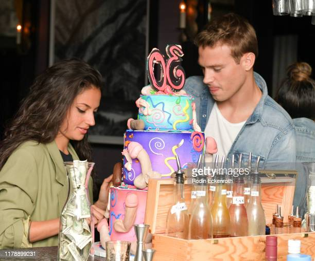 Inanna Sarkis and Matthew Noska pose for portrait at Daniel Nguyen's Birthday Party at Pacifique on October 03 2019 in West Hollywood California