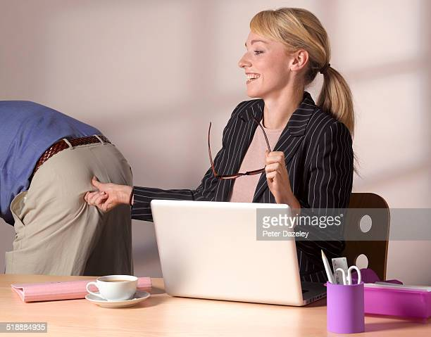 Inappropriate behaviour pinching man's bottom