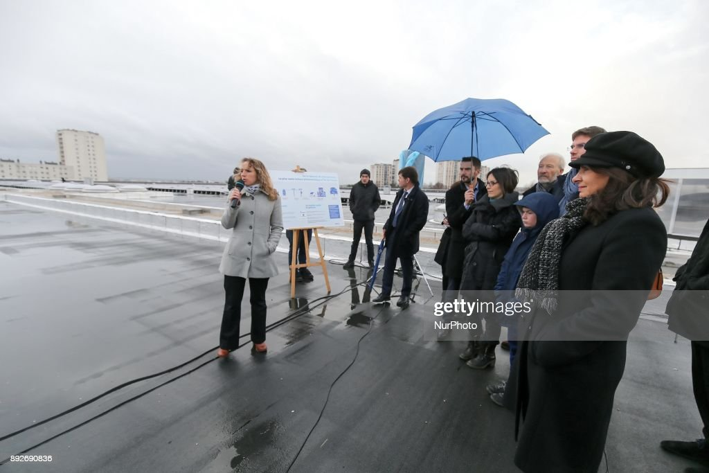 Inauguration by the Mayor of Paris, Anne Hidalgo (1st R), of the largest rooftop photovoltaic power station of the region Ile-de-France, on the roof of the drinking water reservoir in L'Hay-les-Roses, south of Paris, on December 14, 2017.