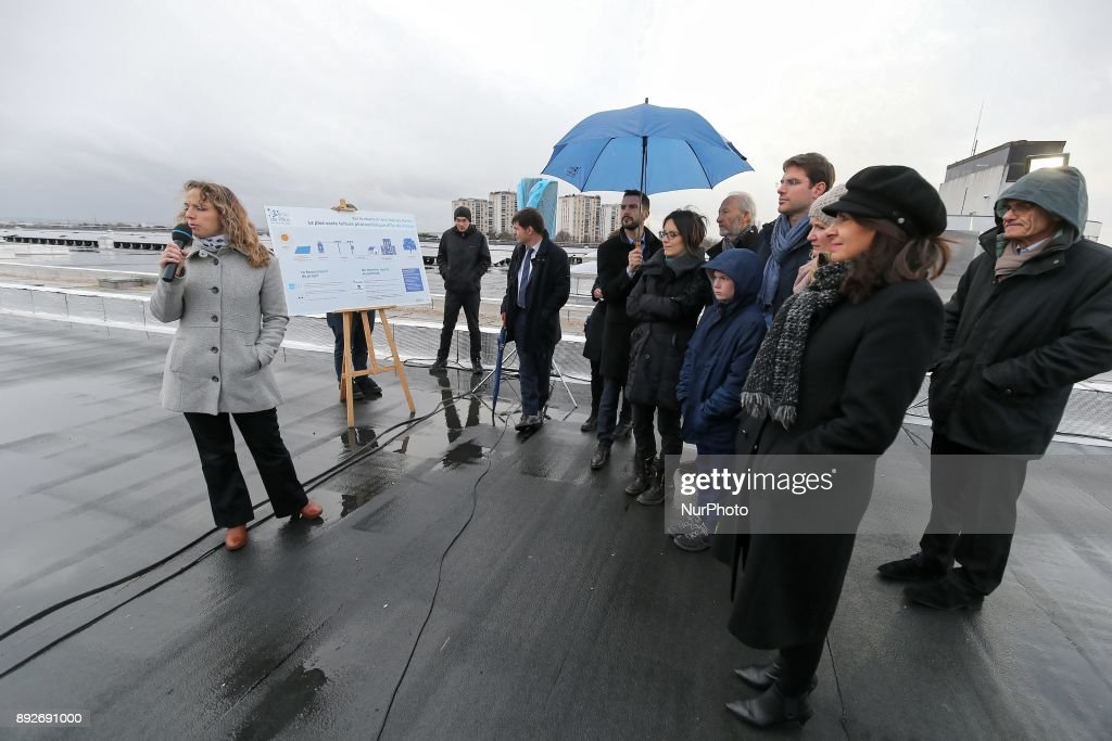 Inauguration by the Mayor of Paris, Anne Hidalgo (2nd R), of the largest rooftop photovoltaic power station of the region Ile-de-France, on the roof of the drinking water reservoir in L'Hay-les-Roses, south of Paris, on December 14, 2017.