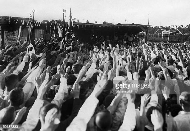 Inauguration of a new swastika banner in an allotment gardens association in Berlin participants sing the national socialist Horst Wessel song their...